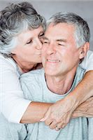 Cheerful mature woman kissing her husband Stock Photo - Premium Royalty-Freenull, Code: 6109-06781887
