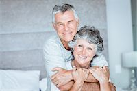 Retired couple posing together on the bed Stock Photo - Premium Royalty-Freenull, Code: 6109-06781892