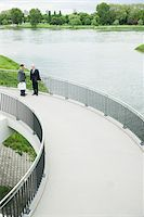 Mature businessmen standing on walkway talking, Mannheim, Germany Stock Photo - Premium Royalty-Freenull, Code: 600-06782208
