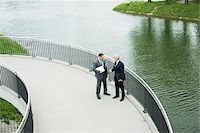 Mature businessmen standing on walkway talking, Mannheim, Germany Stock Photo - Premium Royalty-Freenull, Code: 600-06782209