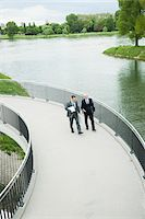 Mature businessmen on walkway talking, Mannheim, Germany Stock Photo - Premium Royalty-Freenull, Code: 600-06782210
