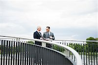 Mature businessmen standing on bridge talking, Mannheim, Germany Stock Photo - Premium Royalty-Freenull, Code: 600-06782221