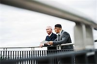 Mature businessmen standing on bridge talking, Mannheim, Germany Stock Photo - Premium Royalty-Freenull, Code: 600-06782225