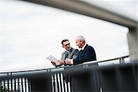 Mature businessmen standing on bridge talking, Mannheim, Germany Stock Photo - Premium Royalty-Freenull, Code: 600-06782226