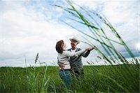 Mature couple dancing in field of grass, Germany Stock Photo - Premium Royalty-Freenull, Code: 600-06782244