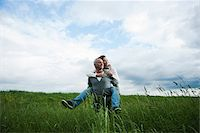 Mature couple in field of grass, man giving piggyback ride to woman, Germany Stock Photo - Premium Royalty-Freenull, Code: 600-06782247