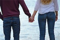 Young couple holding hands by lake, Bavaria, Germany Stock Photo - Premium Rights-Managednull, Code: 700-06786729