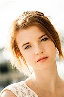 Close-up portrait of teenage girl outdoors, looking at camera Stock Photo - Premium Royalty-Freenull, Code: 600-06786803