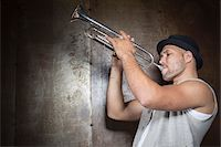Portrait of Musician Playing Trumpet, Studio Shot Stock Photo - Premium Royalty-Freenull, Code: 600-06803953