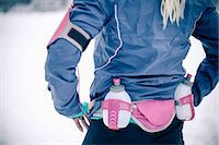Midsection of woman wearing water bottle belt in winter Stock Photo - Premium Royalty-Freenull, Code: 698-06804098