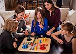 Family of five playing ludo together at table Stock Photo - Premium Royalty-Freenull, Code: 698-06804155