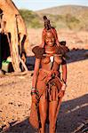Young Himba woman wearing traditional dress and jewellery and with her skin covered in Otjize, a mixture of butterfat and ochre, Kunene Region, formerly Kaokoland, Namibia, Africa Stock Photo - Premium Rights-Managed, Artist: Robert Harding Images, Code: 841-06805770