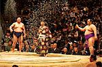 Some sumo fighters throwing salt before a fight at the Kokugikan stadium, Tokyo, Japan, Asia Stock Photo - Premium Rights-Managed, Artist: Robert Harding Images, Code: 841-06807085