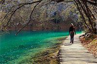 Visitor on wooden walkway path over Crystal Clear Waters of Plitvice Lakes National Park, UNESCO World Heritage Site, Plitvice, Croatia, Europe Stock Photo - Premium Rights-Managednull, Code: 841-06807962