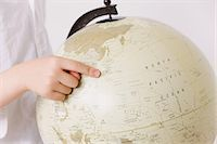 preteen touch - Child pointing a finger on globe Stock Photo - Premium Rights-Managednull, Code: 859-06808669