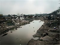 Burnt out wasteland now occupied by travellers, Saint Denis, France Stock Photo - Premium Rights-Managednull, Code: 700-06808746