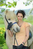 Young woman with a icelandic horse standing under a flowering cherry tree in spring, Germany Stock Photo - Premium Rights-Managednull, Code: 700-06808858