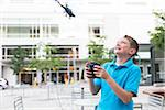Boy playing with a remote control helicopter in an urban park. Stock Photo - Premium Rights-Managed, Artist: Boone Rodriguez, Code: 700-06808954