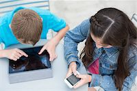 preteen touch - High Angle View of Boy with iPad and Girl with iPhone outside. Stock Photo - Premium Rights-Managednull, Code: 700-06808961