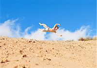 preteen boy shirtless - Boy jumping on beach Stock Photo - Premium Royalty-Freenull, Code: 649-06812028