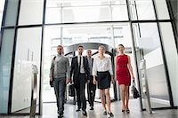 Group of business people walking into glass office building Stock Photo - Premium Royalty-Freenull, Code: 649-06812108