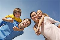 Portrait of family with two children from below Stock Photo - Premium Royalty-Freenull, Code: 649-06812442