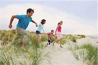 Family holding hands and running at the beach Stock Photo - Premium Royalty-Freenull, Code: 649-06812510