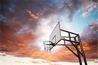 Basketball hoop and dramatic sky Stock Photo - Premium Royalty-Freenull, Code: 649-06812729