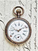 fragile - Pocket watch on handwritten letter Stock Photo - Premium Royalty-Freenull, Code: 614-06813427