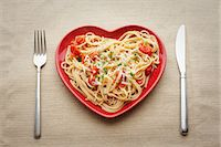 fork - Heart shaped plate with pasta Stock Photo - Premium Royalty-Freenull, Code: 614-06813513