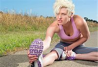 Young woman stretching hamstrings Stock Photo - Premium Royalty-Freenull, Code: 614-06813540