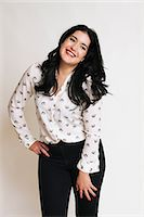 Young woman wearing patterned blouse Stock Photo - Premium Royalty-Freenull, Code: 614-06813585