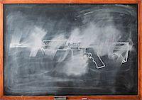 rectangle - Partially erased chalk drawing of gun on blackboard Stock Photo - Premium Royalty-Freenull, Code: 614-06813711