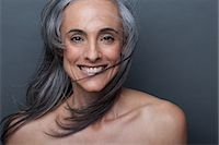 Mature woman with windswept hair Stock Photo - Premium Royalty-Freenull, Code: 614-06814168
