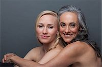Young woman and mature woman hugging Stock Photo - Premium Royalty-Freenull, Code: 614-06814213