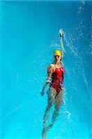 Mature woman doing backstroke in swimming pool Stock Photo - Premium Royalty-Freenull, Code: 614-06814260