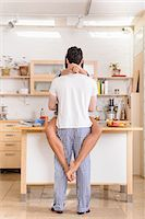 Young couple embracing in kitchen Stock Photo - Premium Royalty-Freenull, Code: 614-06814317