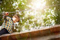 Male toddler crossing wooden footbridge Stock Photo - Premium Royalty-Freenull, Code: 614-06814358