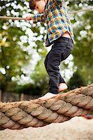 Male toddler crossing rope bridge Stock Photo - Premium Royalty-Freenull, Code: 614-06814360