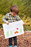 Male toddler holding crayon drawing Stock Photo - Premium Royalty-Free, Artist: Robert Harding Images, Code: 614-06814363