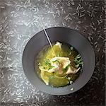 Chinese broth with raviolis