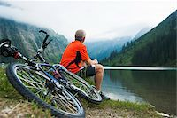 people mountain biking - Mature Man Sitting by Lake with Mountain Bike, Vilsalpsee, Tannheim Valley, Tyrol, Austria Stock Photo - Premium Royalty-Freenull, Code: 600-06819401