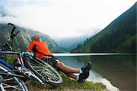 people mountain biking - Mature Man Sitting by Lake with Mountain Bike, Vilsalpsee, Tannheim Valley, Tyrol, Austria Stock Photo - Premium Royalty-Freenull, Code: 600-06819404