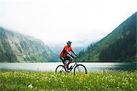 people mountain biking - Mature Man Riding Mountain Bike by Vilsalpsee, Tannheim Valley, Tyrol, Austria Stock Photo - Premium Royalty-Freenull, Code: 600-06819408