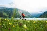 people mountain biking - Mature Man Riding Mountain Bike by Vilsalpsee, Tannheim Valley, Tyrol, Austria Stock Photo - Premium Royalty-Freenull, Code: 600-06819409