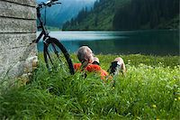 people mountain biking - Mature Man with Mountain Bike Relaxing by Lake, Vilsalpsee, Tannheim Valley, Tyrol, Austria Stock Photo - Premium Royalty-Freenull, Code: 600-06819418