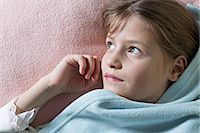 Daydreaming girl under blanket Stock Photo - Premium Royalty-Freenull, Code: 653-06819687