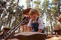Nottinghamshire, UK. Young child playing at Sherwood Pines forest park. (MR) Stock Photo - Premium Rights-Managednull, Code: 862-06825336