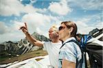 Mature couple looking at map, hiking in mountains, Tannheim Valley, Austria