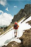 Backview of mature man hiking in mountains, Tannheim Valley, Austria Stock Photo - Premium Royalty-Free, Artist: Uwe Umstätter, Code: 600-06826360